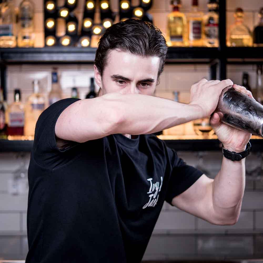Ivy & Jack - bartender shaking cocktail
